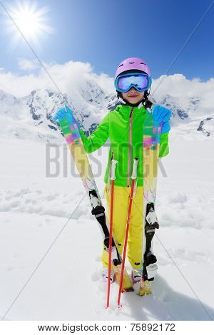 Skiing, skier, winter fun - lovely skier girl enjoying ski vacation