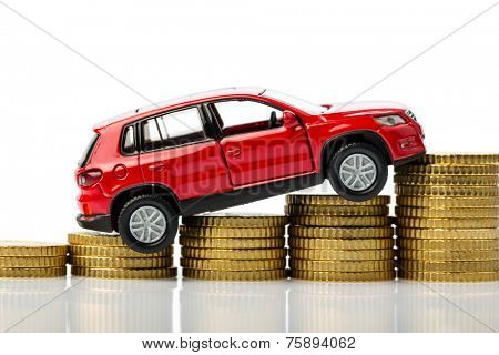 a car stand on a stack of coins