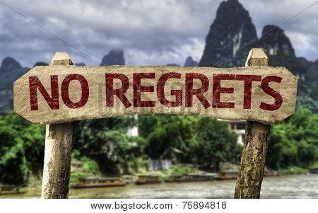 No Regrets sign with a forest background