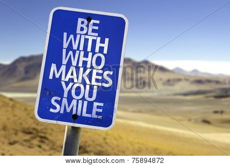 Be With Who Makes You Smile sign with a desert background