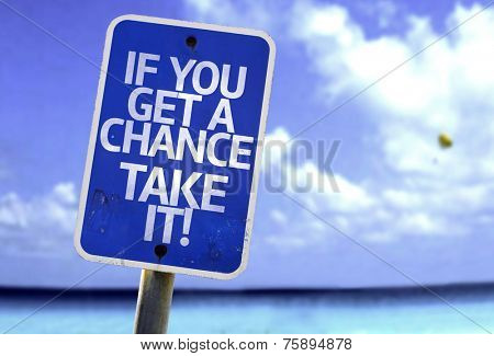 If You Get a Chance, Take It! sign with a beach on background