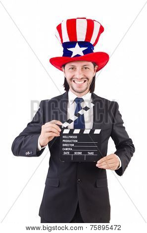 Man with USA hat and movie board isolated on white