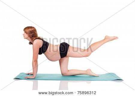 Pregnant woman exerciseing doing yoga. Isolated on white with work path.