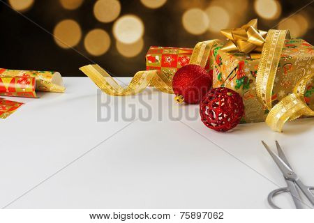 Concept of wrapping presents and gifts with white table copyspace