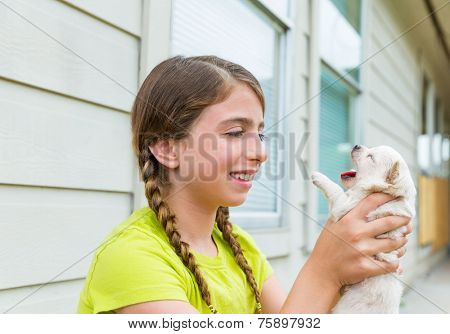 Girl playing with puppy chihuahua pet dog outdoor
