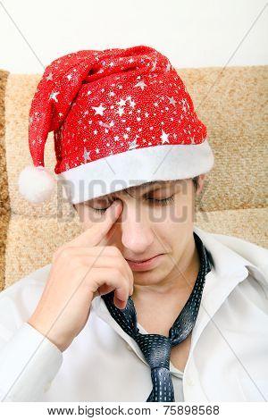 Tired Teenager In Santa Hat
