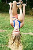 stock photo of swing  - Girl swinging on a swing in park outdoor - JPG