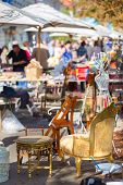stock photo of flea  - Market boot with objects beeing selled at the weekend flea market in the city center - JPG