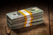 stock photo of 100 dollars dollar bill american paper money cash stack  - Creative business finance making money concept  - JPG