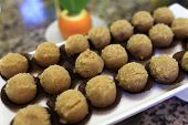 stock photo of cake-ball  - Tray with brown ball cakes at the buffet - JPG