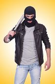 stock photo of hooligans  - Male hooligan with bat on white - JPG
