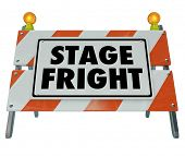 stock photo of public speaking  - Stage Fright words on a barricade or sign to illustrate a fear of public speaking or performance before an audience or crowd - JPG