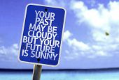 stock photo of past future  - Your Past May Be Cloudy But Your Future is Sunny sign with a beach on background - JPG
