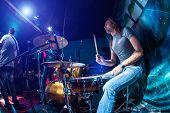 image of drum-kit  - Drummer playing on drum set on stage - JPG