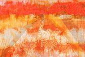 picture of batik  - painted striped orange silk batik close up - JPG
