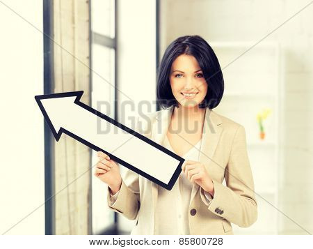 picture of attractive businesswoman with direction arrow sign