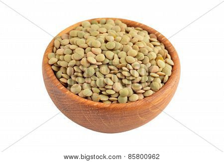 Green lentil in wooden bowl
