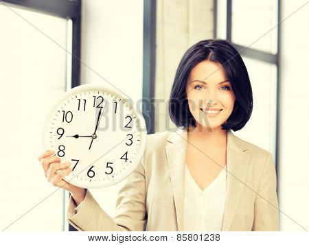 bright picture of attractive businesswoman with clock