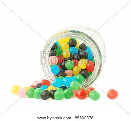 Candy ball sweets falling out of a jar
