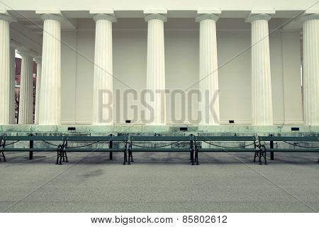 Row Of Columns And Empty Benches