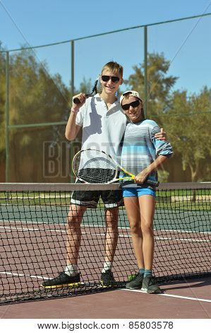brothers playing at tennis