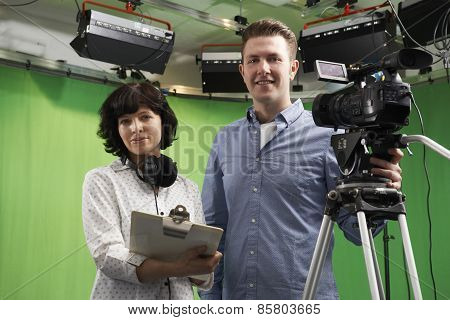 Portrait Of Cameraman And Floor Manager In Television Studio