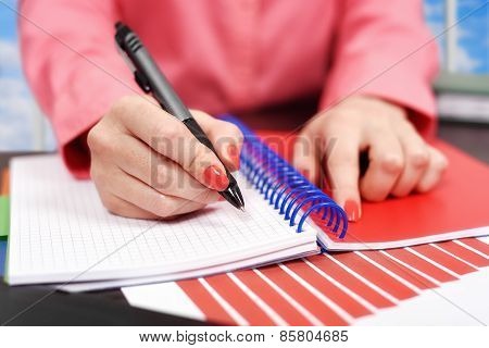 Hand Makes A Note In Notebook