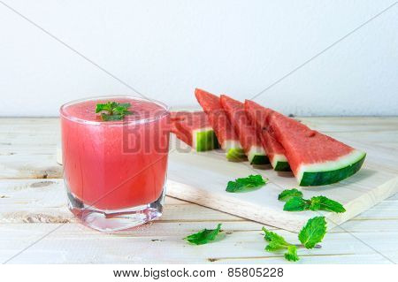 Watermelon Juice With Mint Leaves And Sliced Fruit On The Wood Background. Selective Focus On Mint