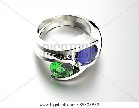 Ring with emerald and sapphire. Jewelry background. Valentine day