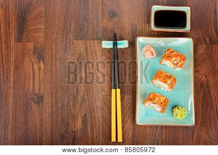 Sushi Rolls On The Wooden Table. View From Above