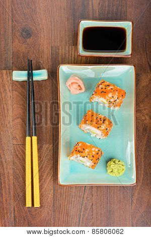 Sushi Rolls On The Wooden Table. Aerial View.