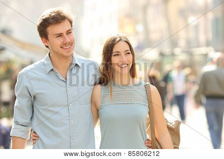 Couple Of Tourists Walking In A City Street
