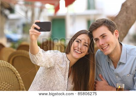 Couple Taking A Selfie Photo In A Restaurant