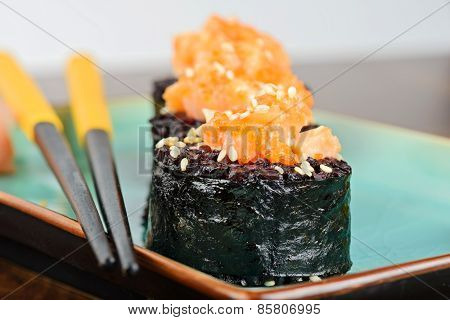 Baked Sushi Rolls Served On Turquoise Plate