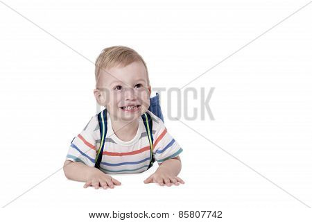 Little boy crawls and laughs