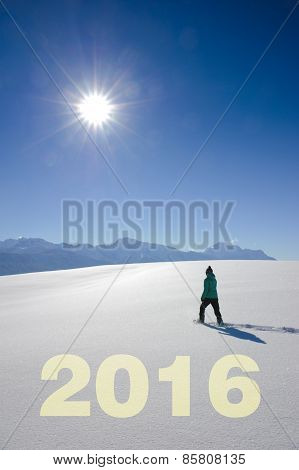 Happy new year 2016 with hiker in snow