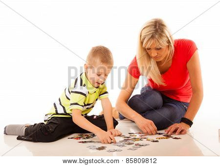 Mother Playing Puzzle Toy With Her Son