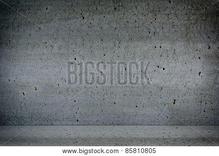 Dark room with concrete walls