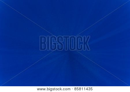 Underwater blue water background with sunlight