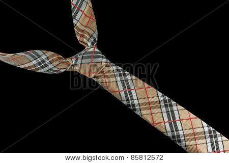 Beige necktie in silk with checkered pattern