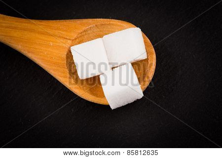White Refined Sugar In Wooden Spoon