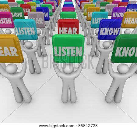 Listen Hear Know words on tiles or signs held up by people or students to illustrate the steps or principles of paying attention and gaining knowledge in education
