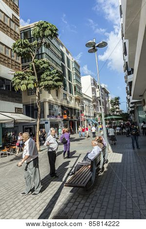 People Walk Along The Pedestrian Zone In Arrecife