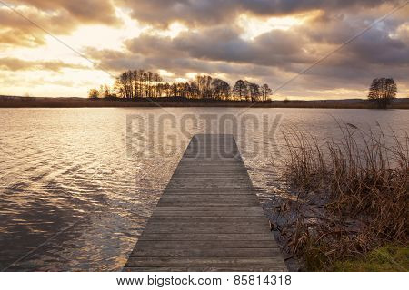 Sunset at the Elbe river, near Darchau, wooden jetty in foreground