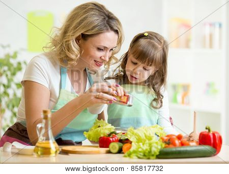 mother with kid make salad