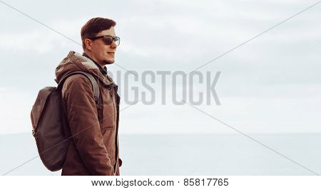 Man Resting On Coastline