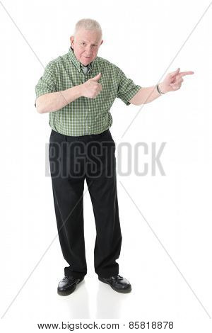 Full length image of a senior adult man happily pointing to his left with a thumbs up gesture.  On a white background.
