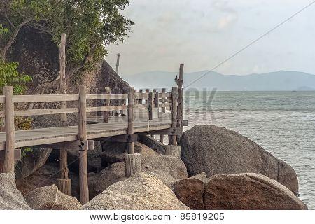 Wooden footbridge to the island of Koh Phangan