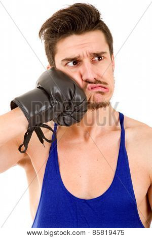 Man punching with black boxing gloves isolated on white background.