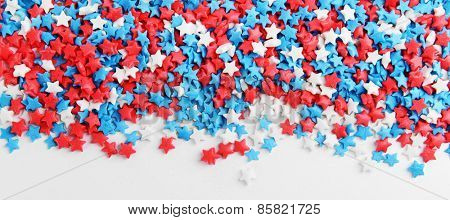 Colorful sprinkles on white background